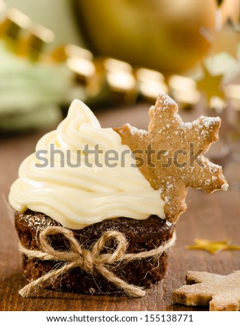 Christmas cupcake with snow flake cookie on top with christmas d - stock photo