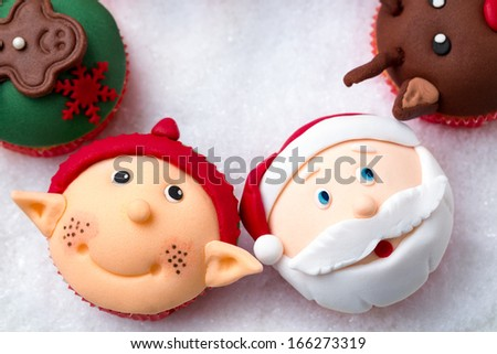 Christmas cupcakes with Santa Claus and Santa helper