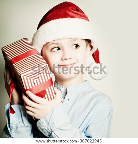 Christmas Curious Child with Gift - stock photo