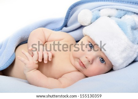 christmas cute baby boy, beautiful infant in Santa's hat and blue soft plaid with vivid positive expression - stock photo