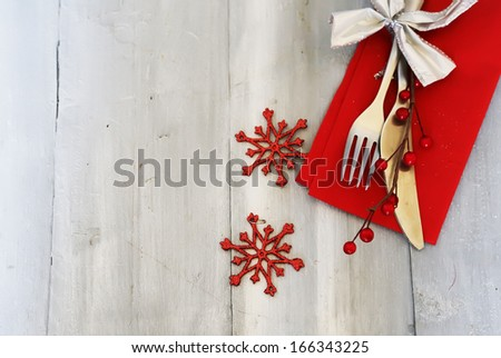 Christmas day greeting card with plate, knife and fork - stock photo