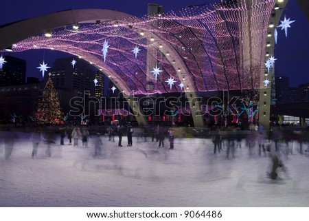 Christmas day, skaters at Toronto city hall ice rink - stock photo