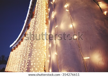 Christmas decor in night city - stock photo