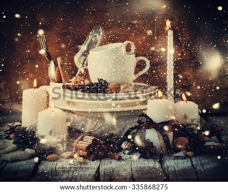 Christmas Decor on the Table in Festive Composition. Dishware, Candles, Cinnamon, Pine cones, Walnuts. Country style. Effect Drawn Snow - stock photo