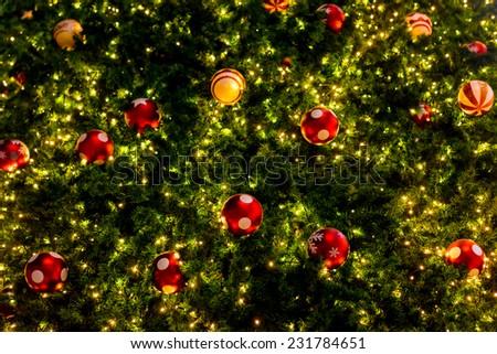 Christmas decor on tree with light decor.  - stock photo