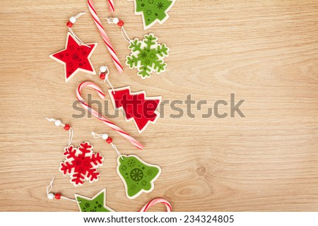 Christmas decor on wooden background with copy space - stock photo