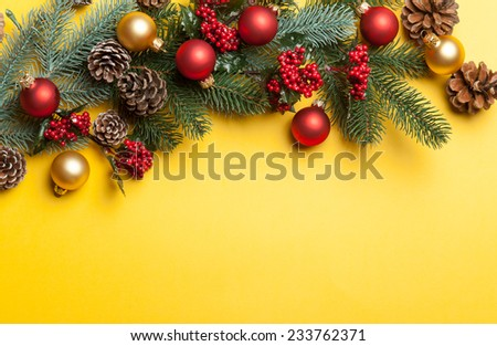 Christmas decorate on yellow background.