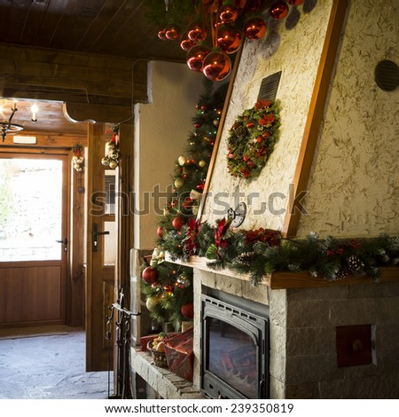 Christmas decorated fireplace - stock photo