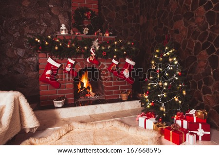 Christmas decorated fireplace and tree in the room - stock photo