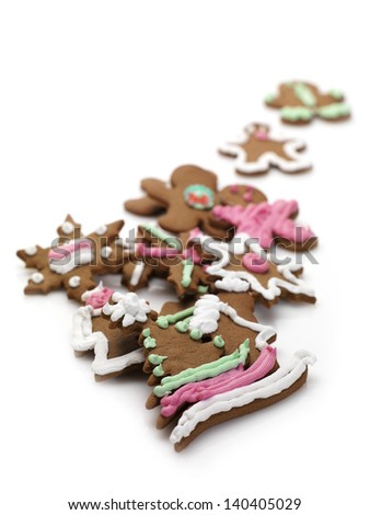 christmas decorated gingerbread biscuits on a white background - stock photo