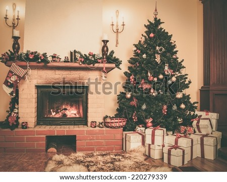 Christmas decorated house interior with fireplace  - stock photo