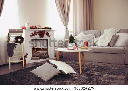 Christmas decorated room with fireplace - stock photo