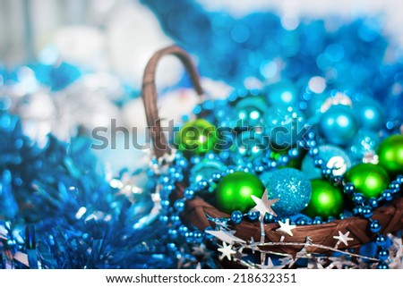 Christmas decoration. Abstract blue holiday decorations: baubles, stars, tinsel and garland. Blurred image with selective focus toned in vintage colors. - stock photo