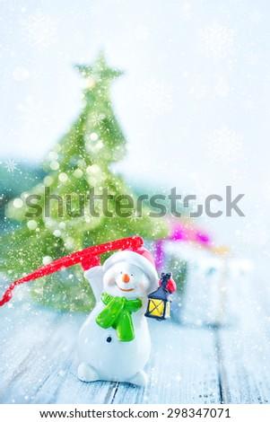 christmas decoration and christmas tree on a table - stock photo
