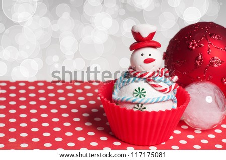 Christmas decoration and cupcake on bokeh background - stock photo