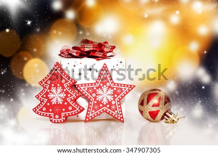 Christmas decoration and gift box on bokeh background