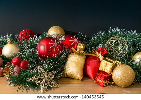 Christmas decoration and gift boxes over dark background - stock photo
