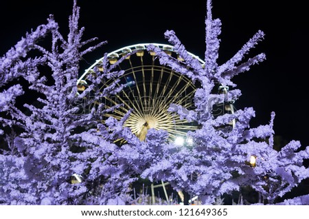 Christmas decoration and illumination in the place massena in Nice, France. Long time exposure. Unrecognizable faces. - stock photo