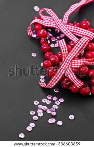 Christmas decoration and pink sequins on dark background - stock photo