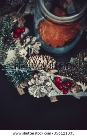 Christmas Decoration and Top View Composition. Fir tree, Pine cones, and Spruce. Cinnamon cookies in glass jar - stock photo