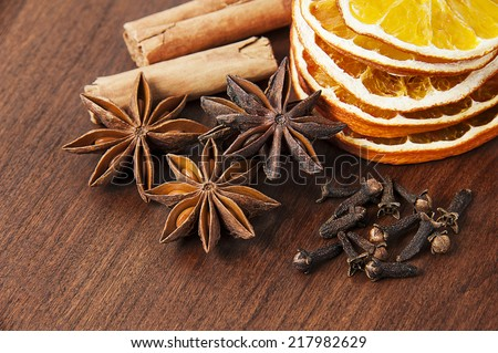 christmas decoration - anise stars, orange slices, cinnamon and cloves - stock photo