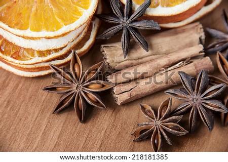 christmas decoration - anise stars, orange slices, cinnamon sticks - stock photo