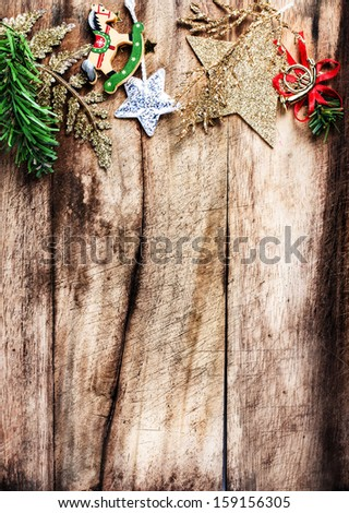 Christmas decoration as border with  copyspace on wooden old background. Vintage Christmas tree frame.  - stock photo