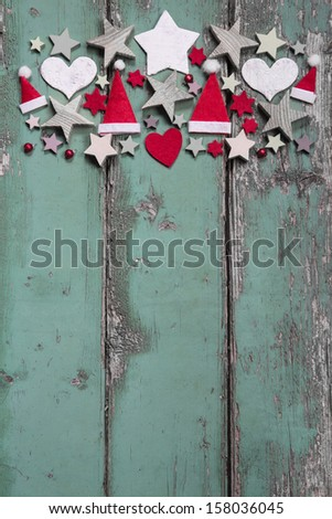 Christmas decoration at top on shabby green wooden background for a frame - stock photo