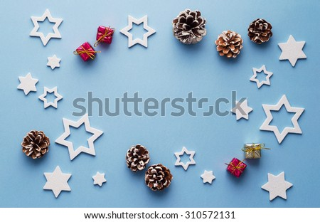 Christmas decoration background over blue background, above view with copy space for text or other design - stock photo