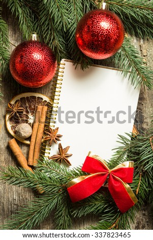 Christmas decoration background. Winter recipe note with ingredients for mulled wine: cinnamon, star anise, nutmeg and dried citrus. Top view image - stock photo