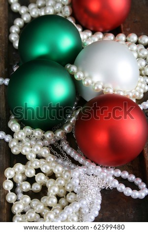 Christmas decoration balls and pearl jewellery necklaces