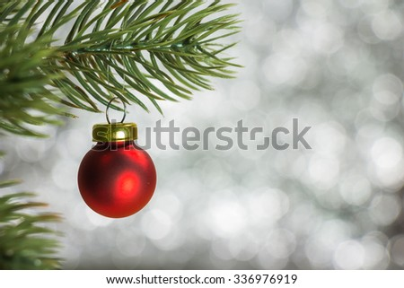 Christmas decoration, bauble ball hanging on fir tree over abstract bokeh background, selective focus - stock photo