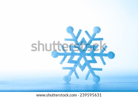 Christmas decoration. Beautiful snowflake on real snow outdoors. Winter holidays concept. - stock photo