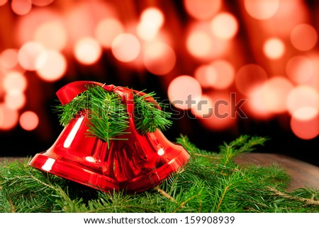 Christmas Decoration Bells on Spruce Twigs. - stock photo