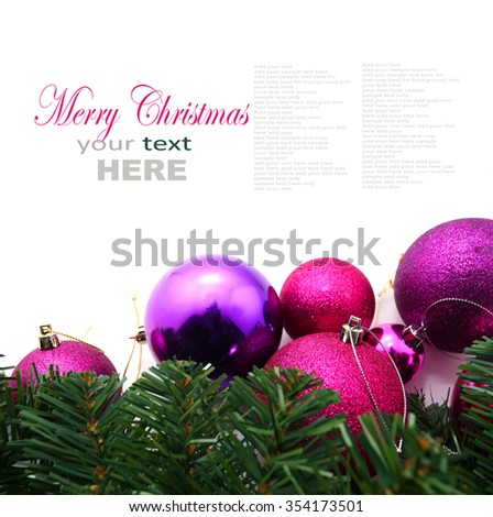 Christmas decoration (branch of spruce tree, pink and purple baubles) isolated on white background with copy space - stock photo