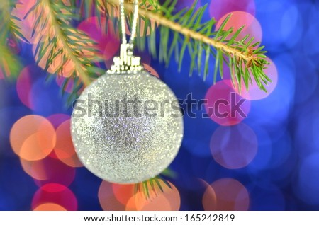 christmas decoration, Christmas ball hanging on spruce twig against bokeh background
