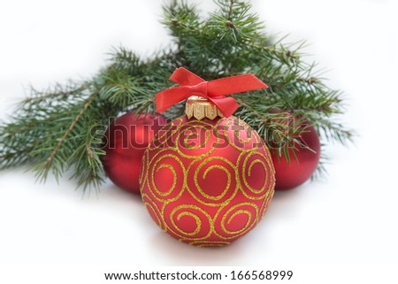 Christmas Decoration: Christmas red ball, twig of fir. Holiday Decorations Isolated on White Background