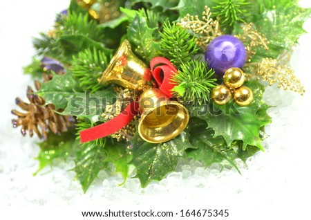 christmas decoration, Christmas wreath on icy surface - stock photo