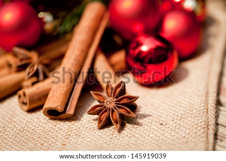 christmas decoration cinnamon anise baubles in red macro closeup - stock photo