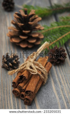 Christmas Decoration - cinnamon sticks and pine on a  wooden background - stock photo