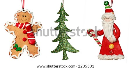 Christmas Decoration - Composite of three full size isolated images - Ginerbread man, Christmas tree and Santa - stock photo