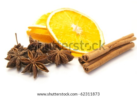 christmas decoration: dried orange, cinnamon and anise isolated - stock photo