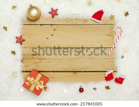 Christmas decoration, frame of artificial snow on wooden background - stock photo
