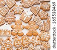 Christmas decoration. Gingerbread cookies on the white background  - stock photo