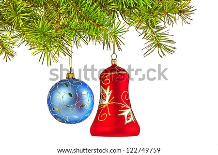 Christmas decoration-glass red bell and blue ball on fir branch - stock photo