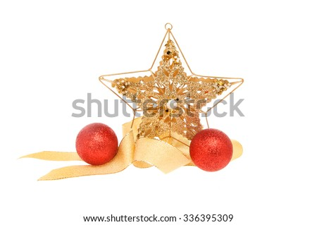Christmas decoration, gold glitter star with red baubles and gold ribbon isolated against white - stock photo