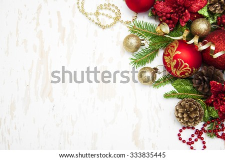 Christmas decoration golden baubles with Christmas tree on a wooden background