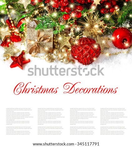 Christmas decoration golden ornaments and lights. Festive still life wit sample text. - stock photo