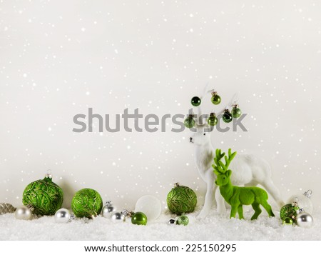 Christmas decoration: green reindeer on wooden white background. - stock photo