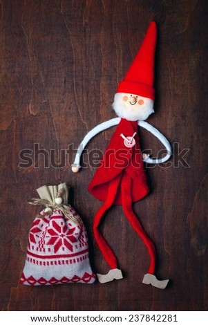 Christmas decoration (handmade toy) over wooden background . - stock photo